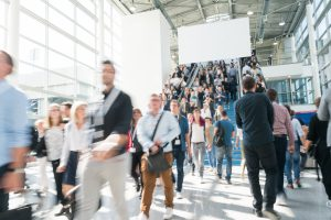 blurred people at a trade show for networking for freelancers