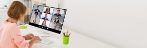 freelancer worker collaborating with colleagues on a video call