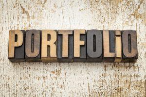 portfolio word in wood type to represent building a portfolio career