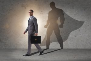businessman with cape trying to be brave