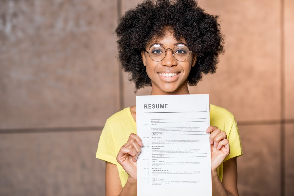 freelance worker holding up a resume of her work experience