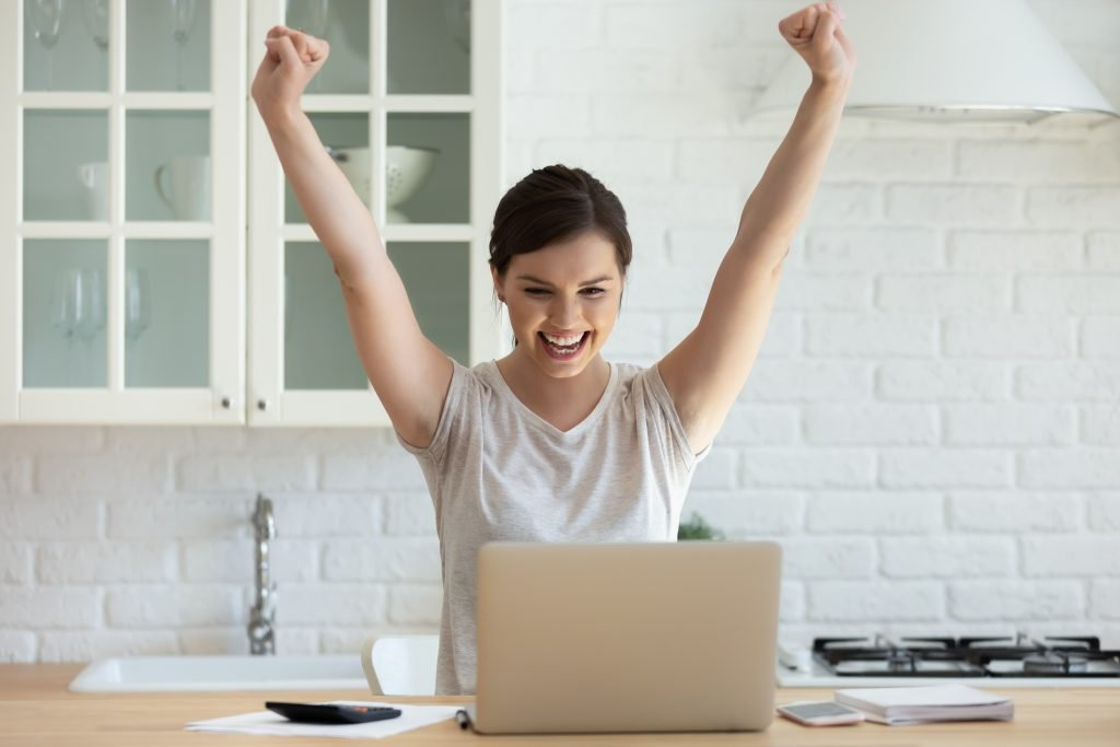 happy woman freelancer at her computer